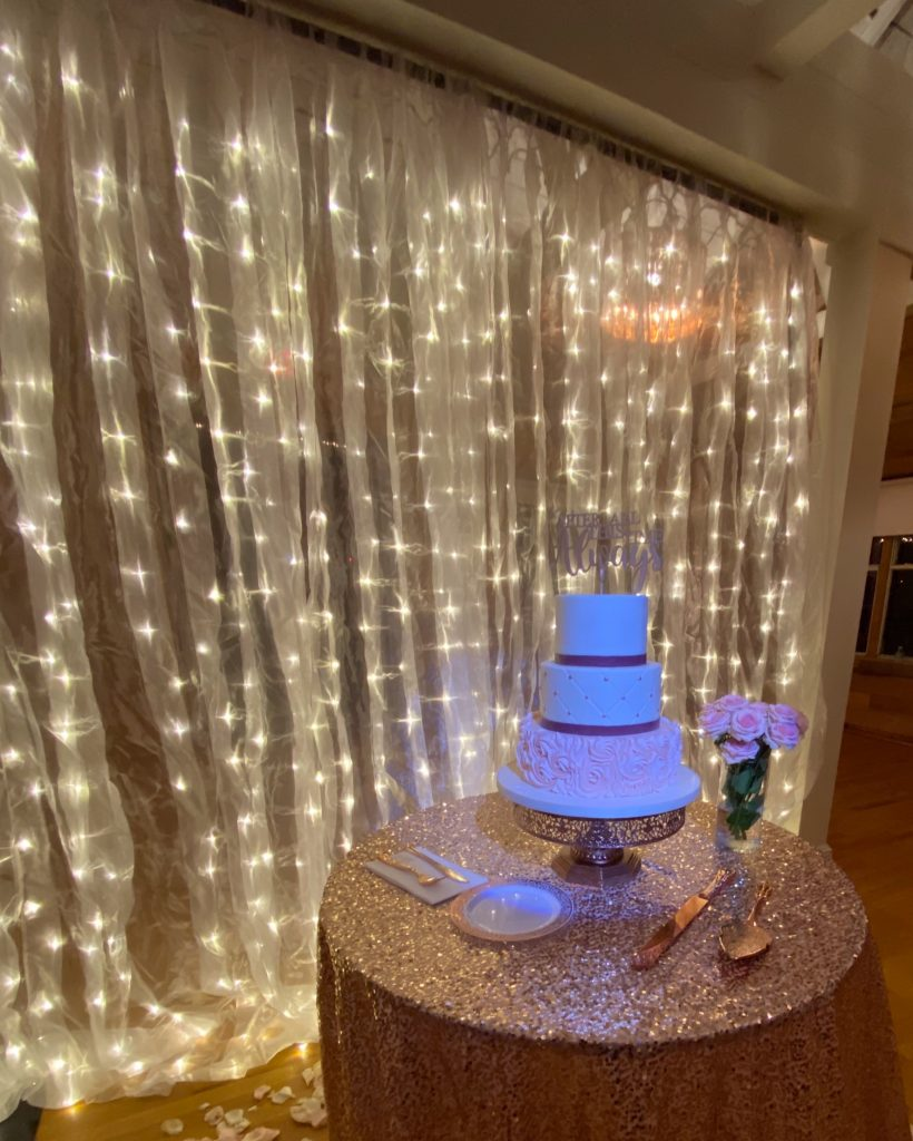 Warm white LED backdrop behind a wedding cake